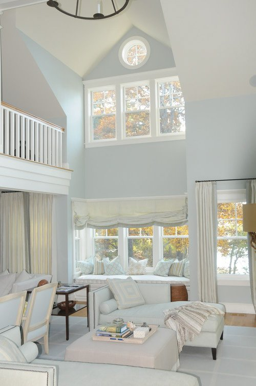Living space with vaulted ceilings and lots of natural light, and walls painted in Benjamin Moore Quiet Moments.