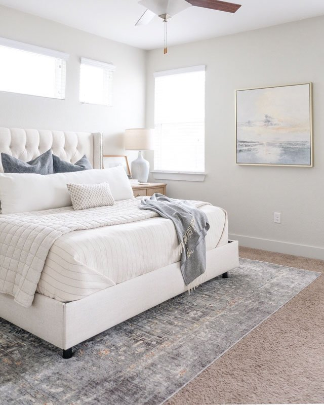 Behr Silver Drop captures the essence of a gray sky at sea in this serene bedroom.