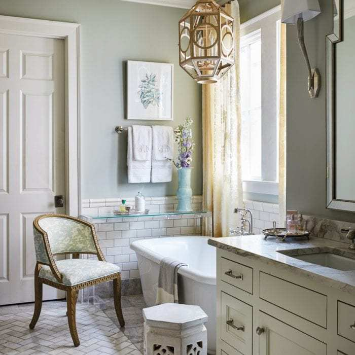 Eclectic vintage bathroom with walls painted in Benjamin Moore Quiet Moments.