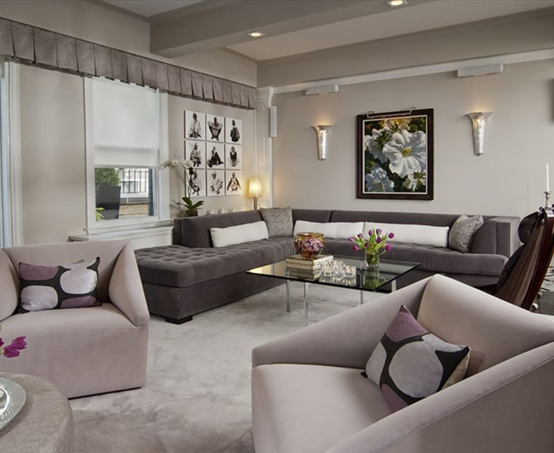 A sophisticated living space featuring a large sectional and Sherwin Williams Alpaca on the walls.