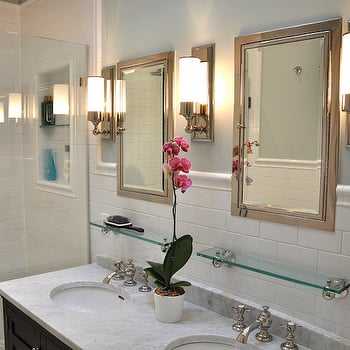 Elegant bathroom with white subway tile backsplash, polish nickel-framed mirrors and pretty, pale marble countertops. Upper wall is Quiet Moments paint by Benjamin Moore.