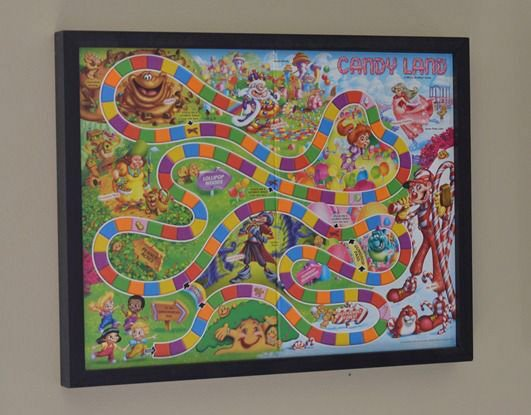 Candy land board game framed on a wall