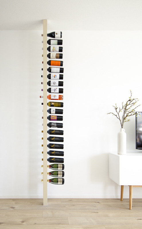 holes drilled in vertical wood to create wine tower sculpture