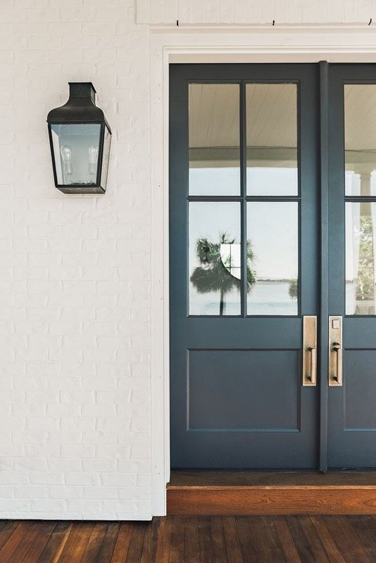 Benjamin Moore Wrought Iron exterior double featured on a white brick house.