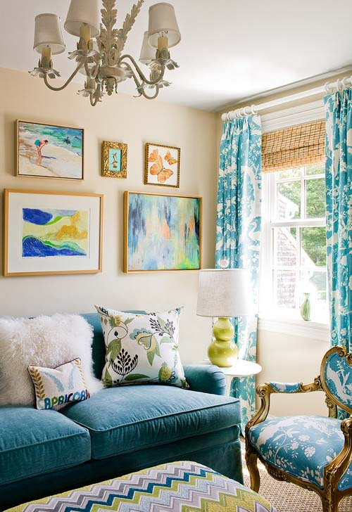Benjamin Moore's Manchester Tan paint in a living area, accented with blue and turquoise decor.