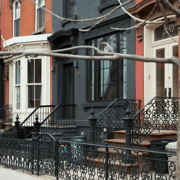 Exterior of a brick townhouse style home painted entirely in Wrought Iron paint.