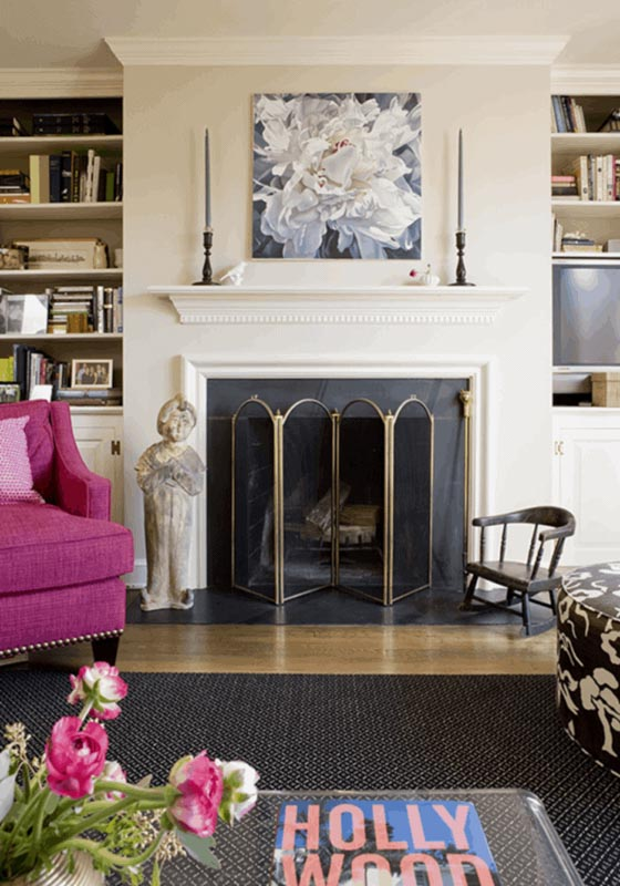 A boldly accented living room painted in BM Manchester Tan, the fireplace and mantle front and center.