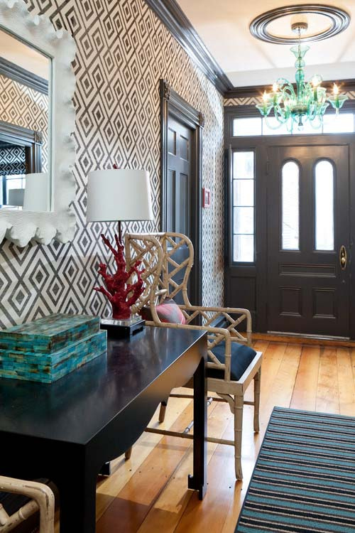 An eclectic entry way with interior doors painted in wrought iron black.