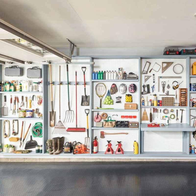 Garage wall filled with organized pegboard