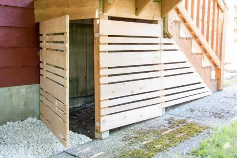 secret storage compartment under deck stairs