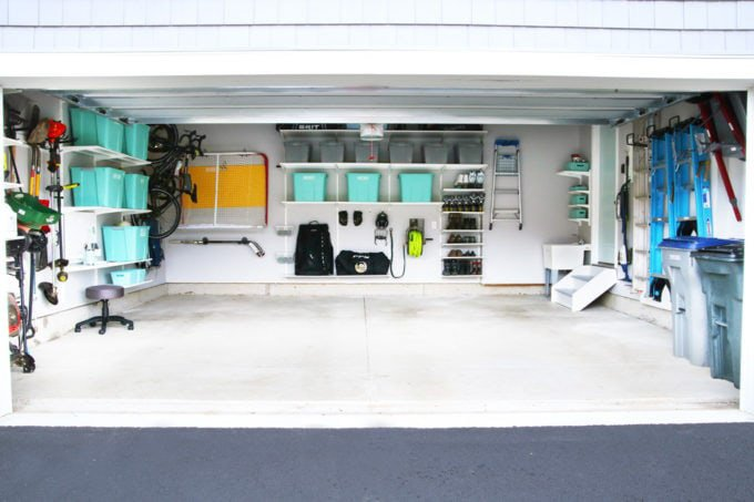 Organized garage with teal storage boxes