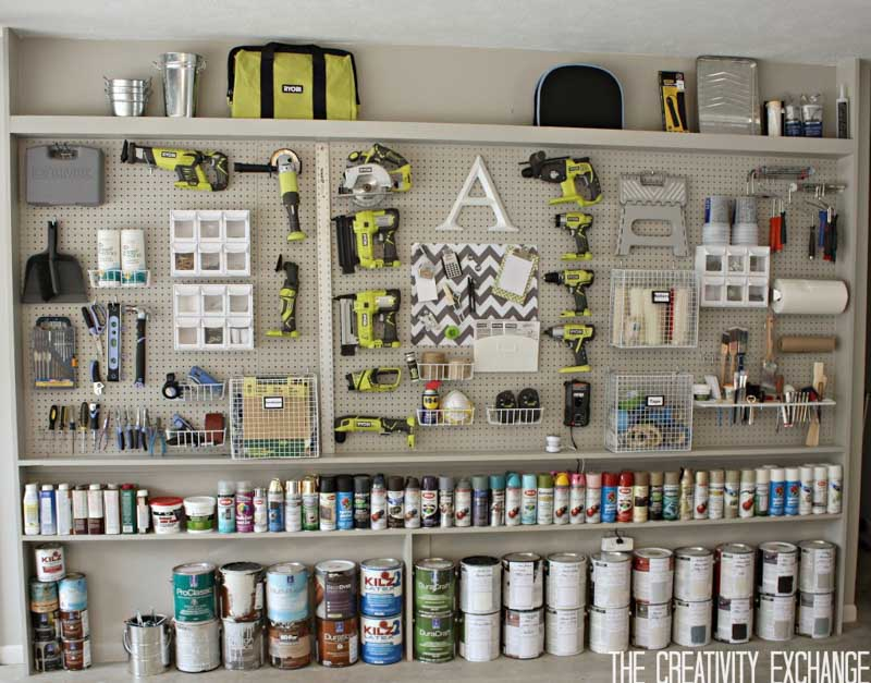 Garage storage solutions for narrow spaces - shelves filled with paint cans and spray paint with pegboard above it