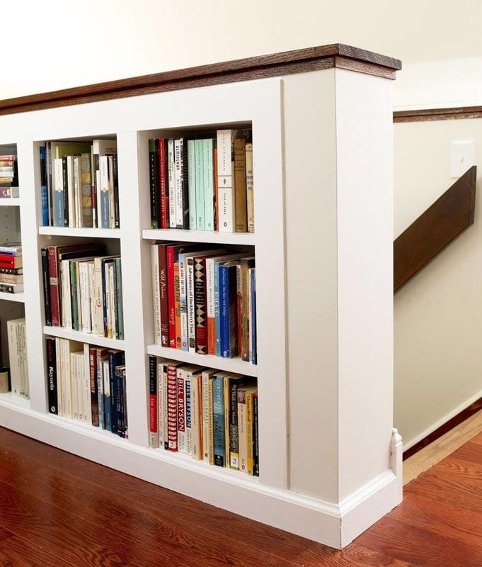 attic railing with bookshelf built into it