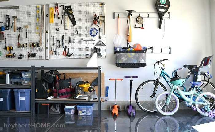 Garage organized with pegboard and shelves and a shiny floor