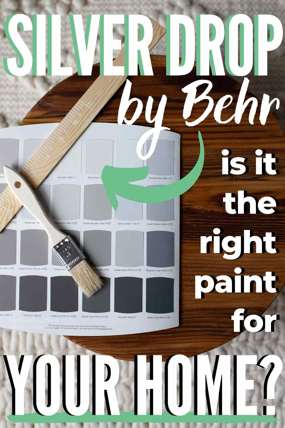 Silver Drop by Behr - is it the right paint for your home? Paint swatches lying on wood tray with paint stirrer and paint brush lying on top of paint chips