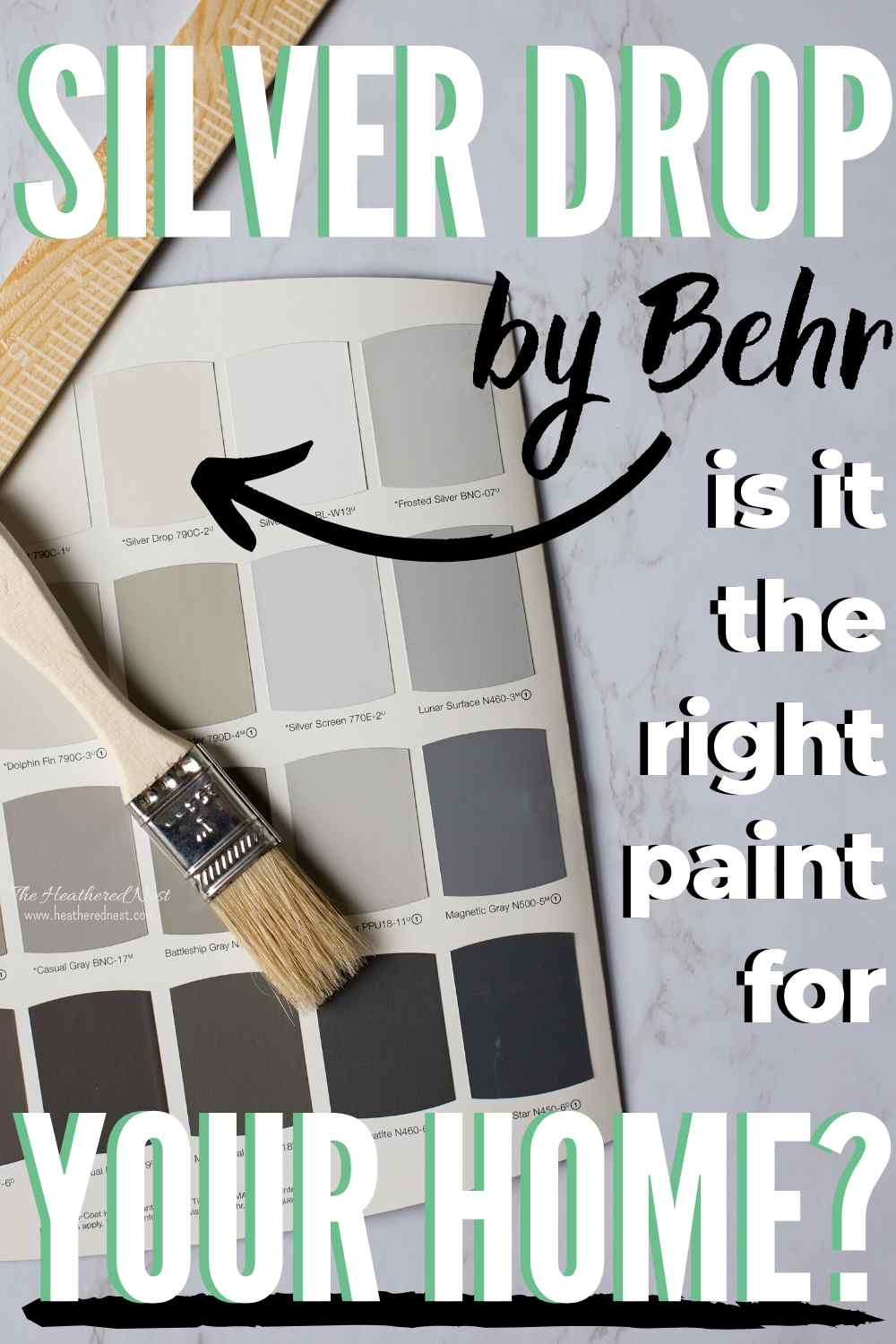 Silver Drop by Behr - is it the right paint for your home? Paint swatches lying on marble counter with paint stirrer and paint brush lying on top of paint chips