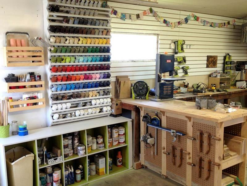Organized garage filled with paint and woodworking supplies neatly tucked away