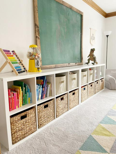 Cube shelving with wicker baskets full of toys in a playroom.