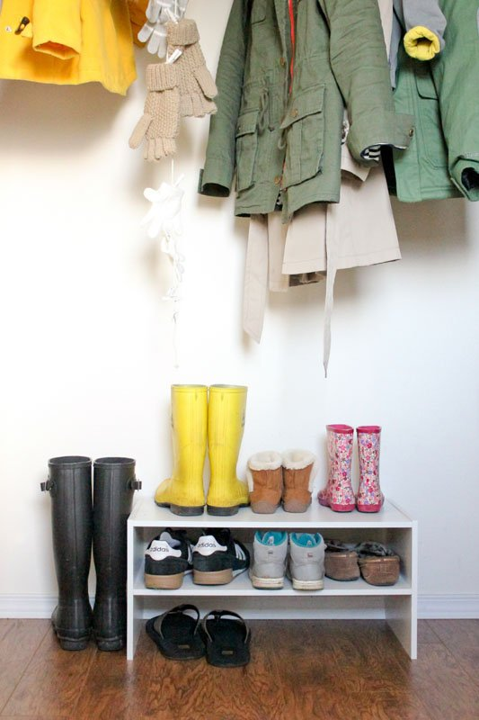 minimalist coat closet with hanging glove storage