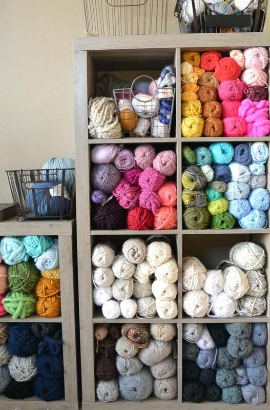 ikea kallax filled with colorful yarn