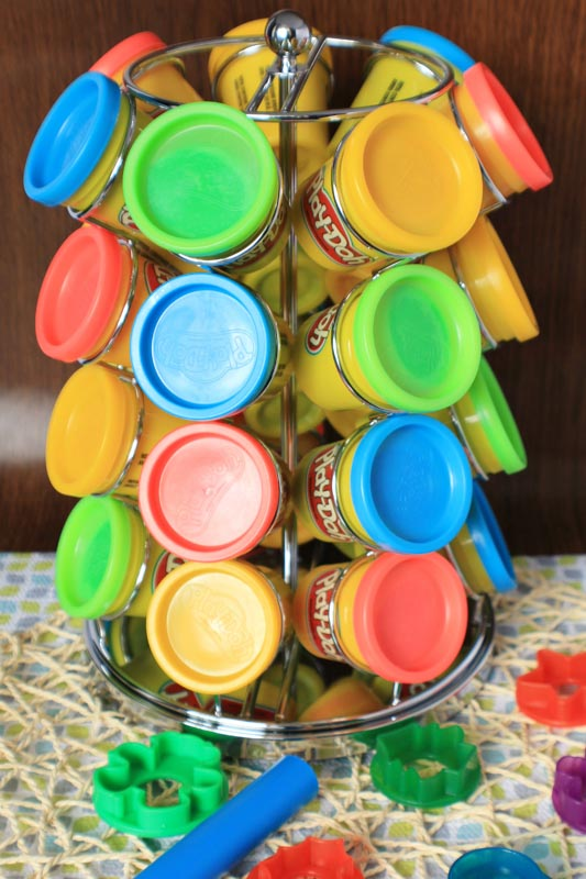 Small containers of play dough stored in a coffee pod carousel.