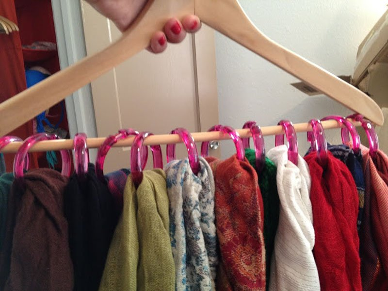 shower curtain rings hung on hanger for DIY scarf storage