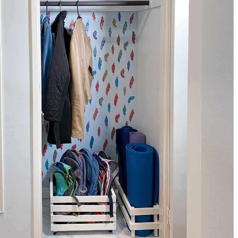 coat closet organized with rolling bins