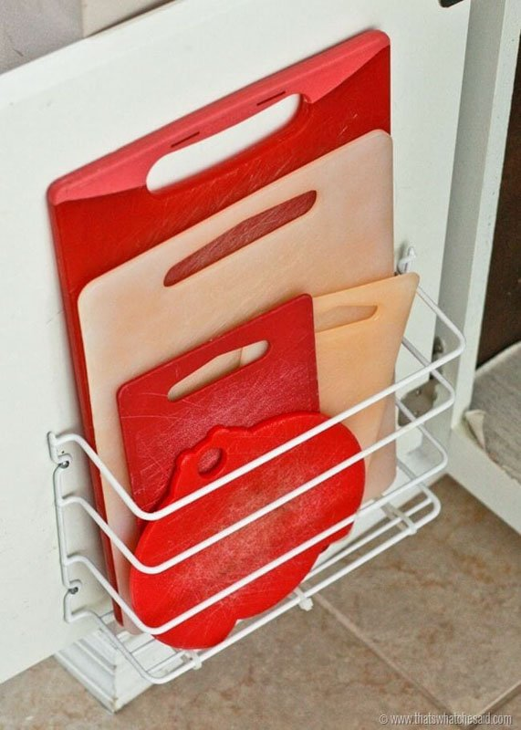 cutting boards stored on a cabinet door