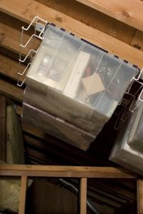 attic storage with boxes hanging from ceiling