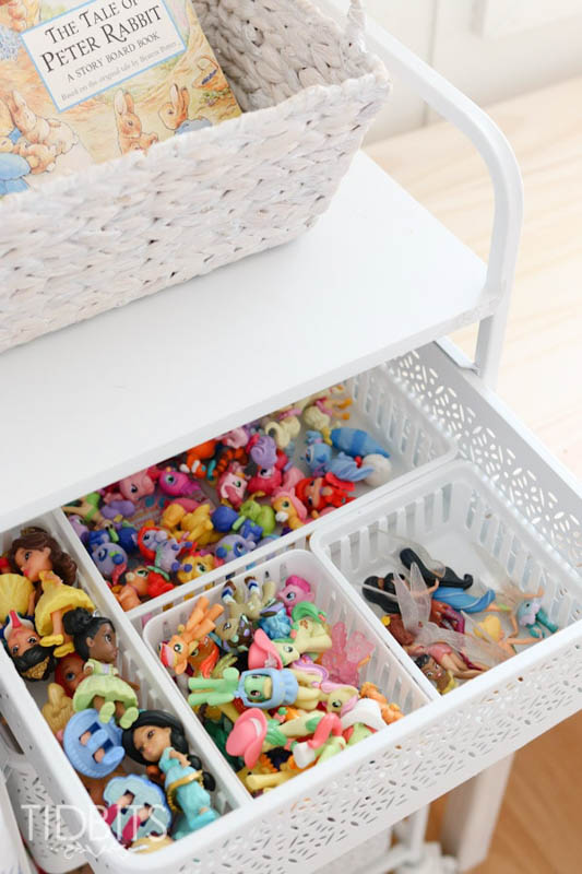 toys divided into bins inside a drawer