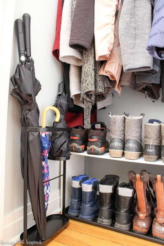 Coat closet with a narrow umbrella stand