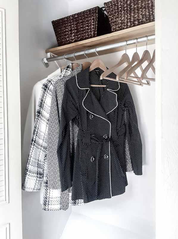 coat closet organization featuring matching hangers