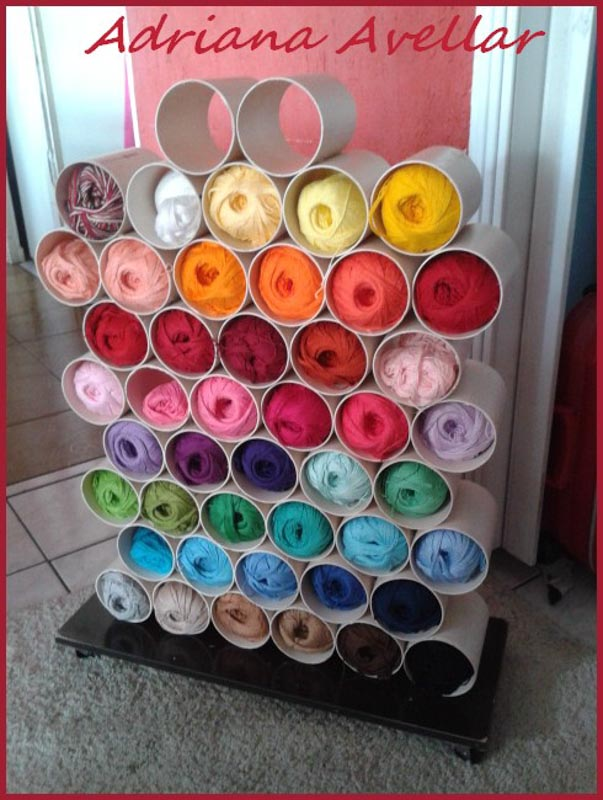 Stacked sections of PVC pipe housing colorful yarn