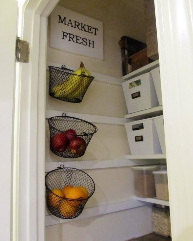 baskets from the dollar tree hung in a pantry