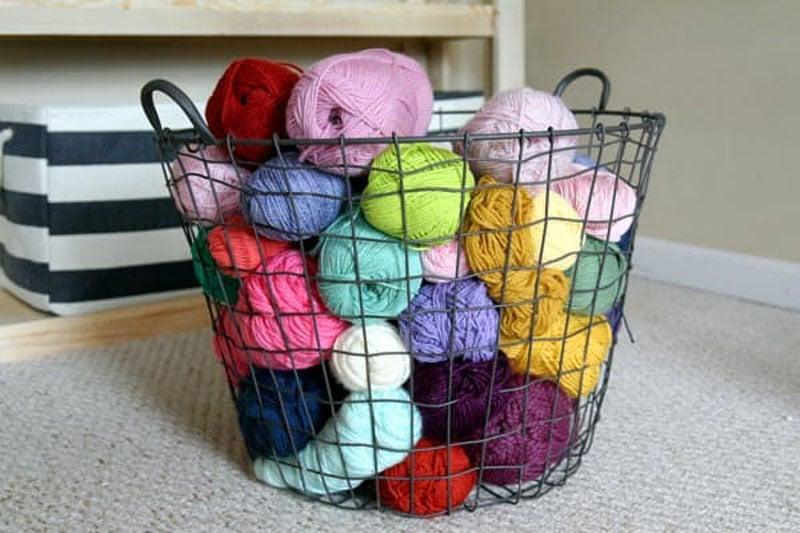 a wire basket used as yarn storage