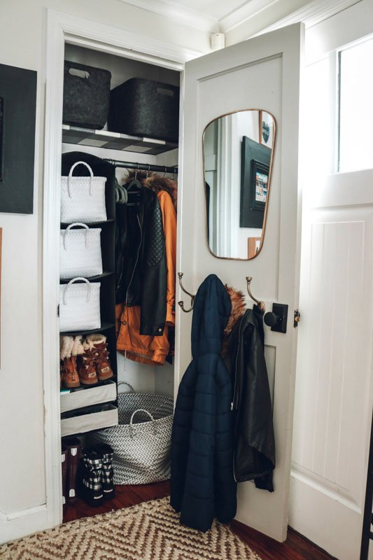 coat closet with mirror hanging on the inside