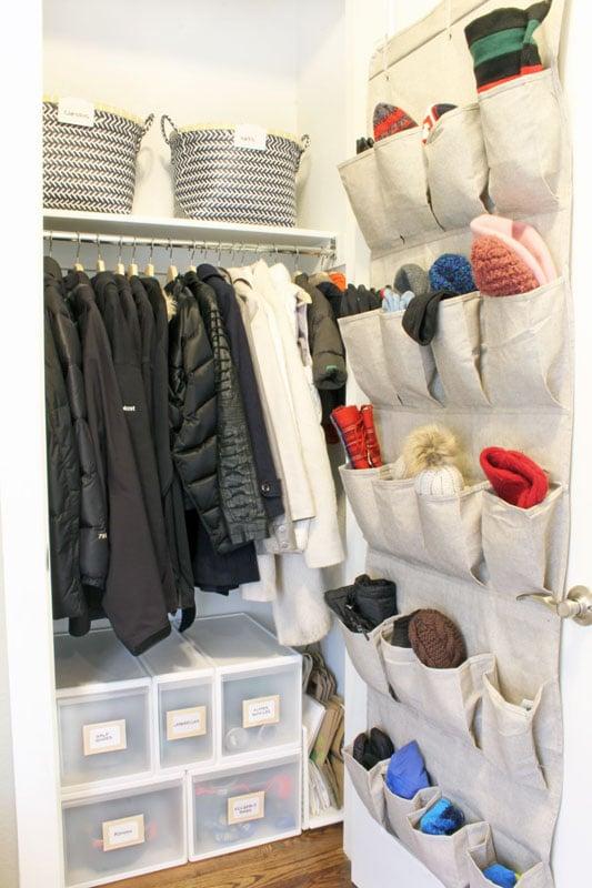 small coat closet organization idea - use storage boxes on the floor