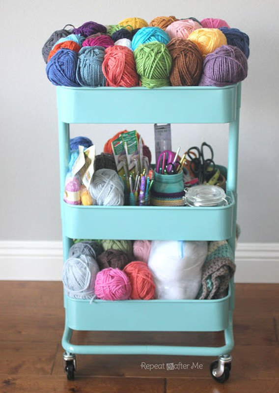 rolling storage cart filled with knitting supplies