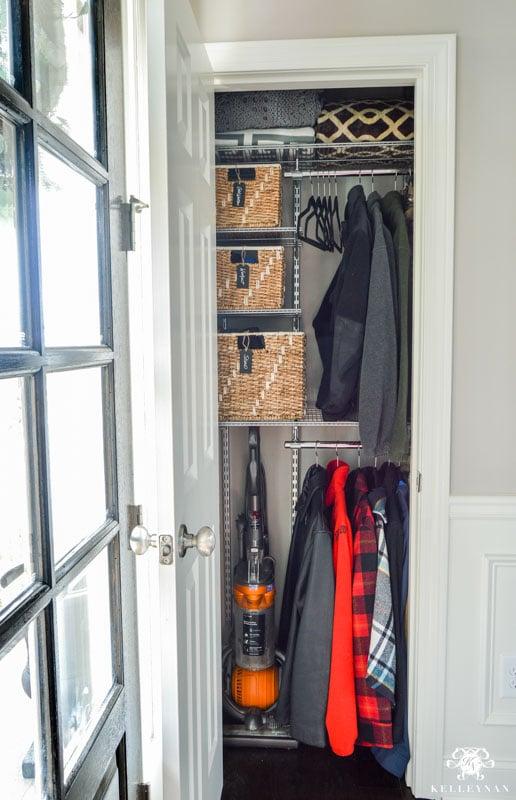 small coat closet organized with the elfa system