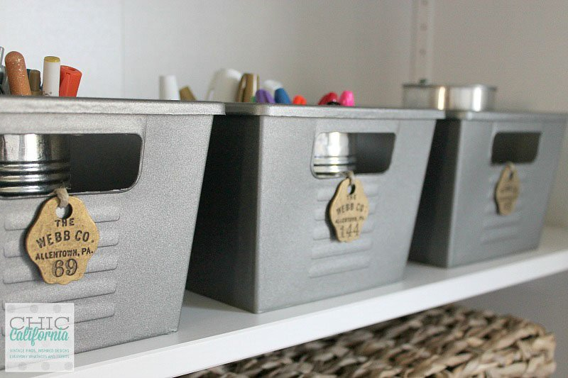 row of bins from the dollar store spray painted silver