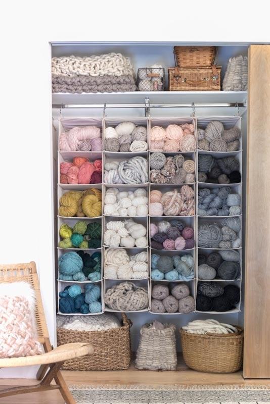 yarn stored in hanging clothing bins