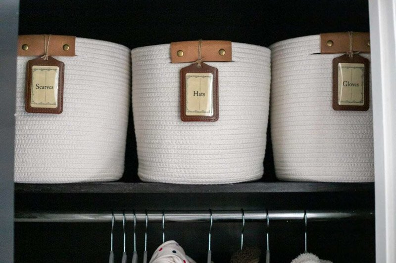 labeled baskets for scarves, hats, and gloves