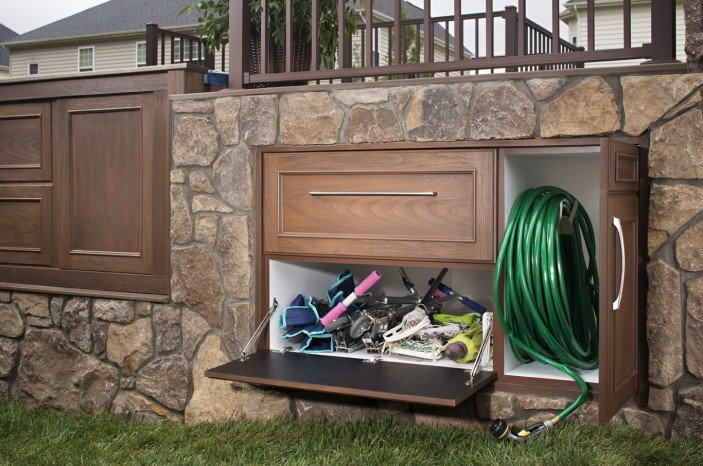 Swanky Kitchen Style Under Deck Storage Drawers via Trex - seen holding a hose and kids outdoor toys