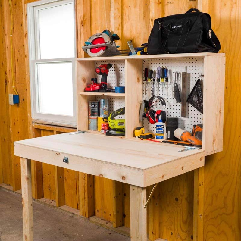 A small wooden workbench on the wall of a shed, holding various tools and supplies for projects.