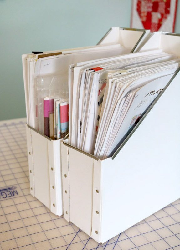 Magazine holders filled with neatly folded sewing patterns.