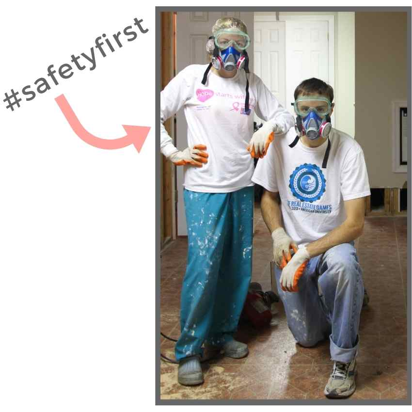 couple wearing work clothes and respirator masks during DIY project with text hashtag safety first