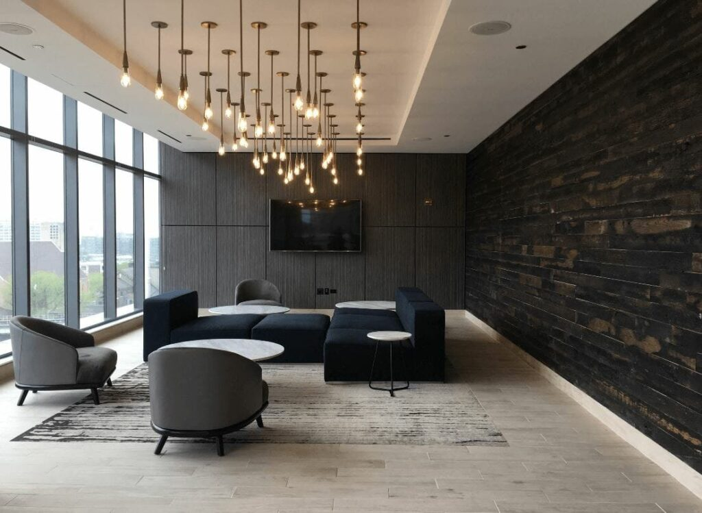 A very modern sitting space on an upper floor of a building, featuring dark charcoal paint.