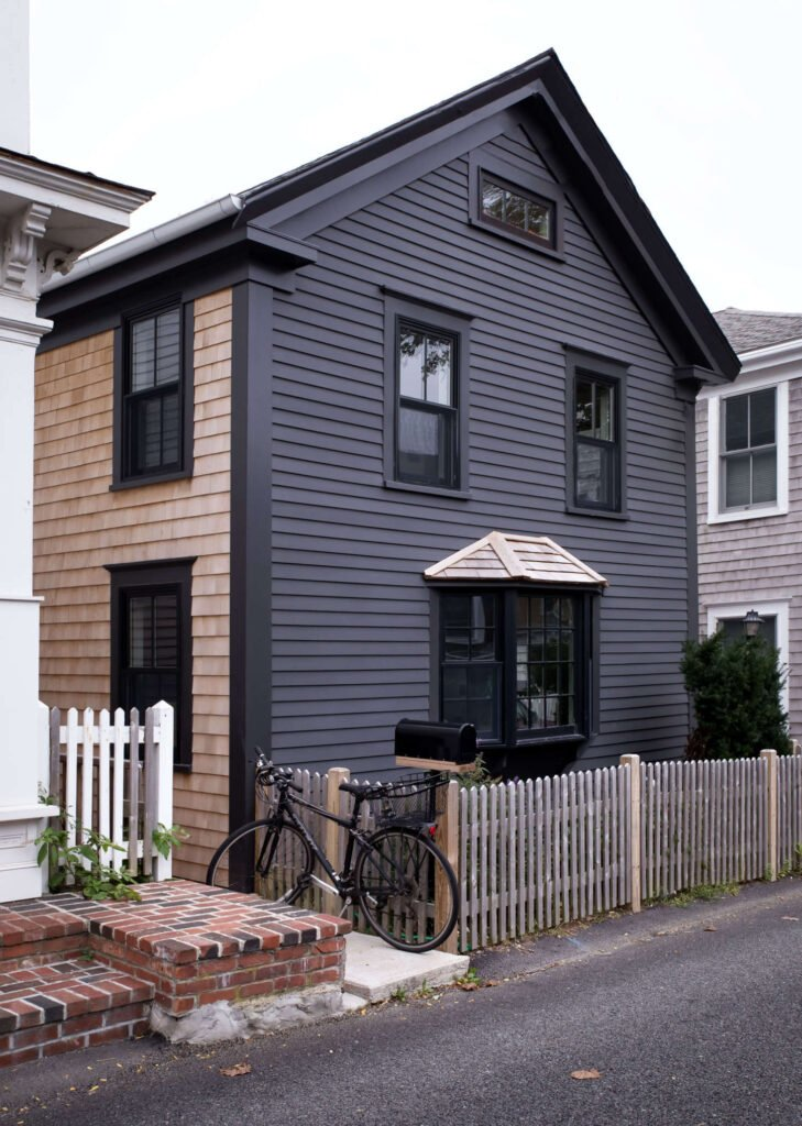 Siding of a home coated in Benjamin Moore Wrought Iron exterior paint.