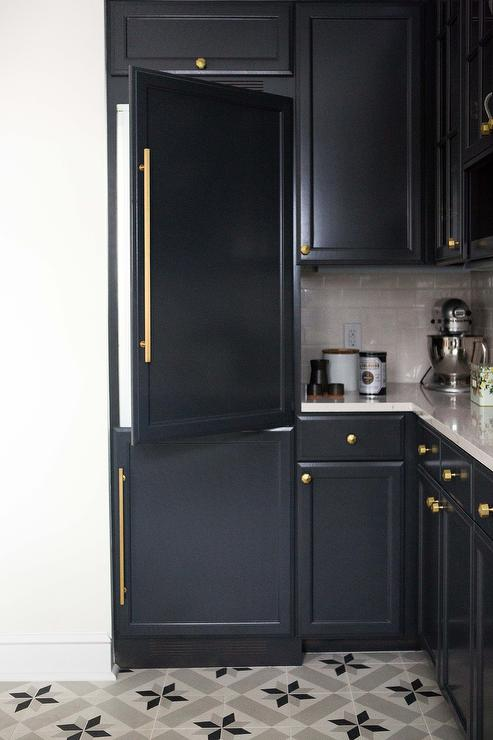 A kitchen corner with cabinet doors painted in a charcoal black color.