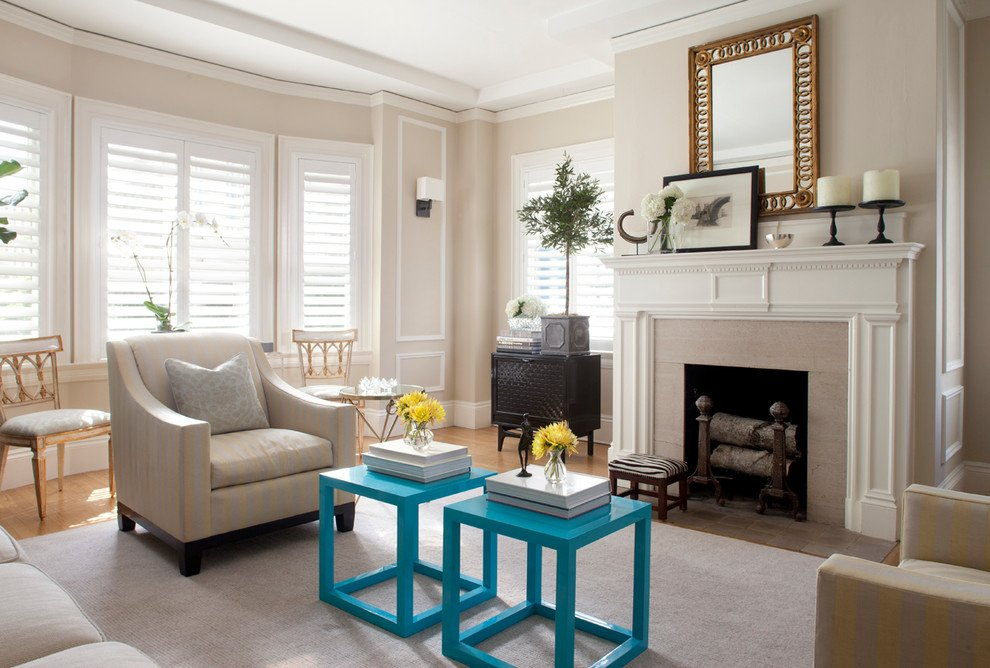 A chic sitting room featuring a fireplace as the focal point, and turquoise side table accents in a Manchester Tan painted space.